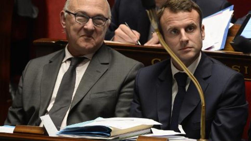 Le ministre des Finances Michel Sapin et le ministre de l'Economie Emmanuel Macron le 28 octobre 2014 à l'Assemblée nationale à Paris