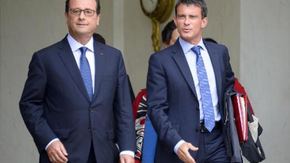 Le président de la République François Hollande (g) et le Premier ministre Manuel Valls, le 27 août 2014 sur le perron de l'Elysée