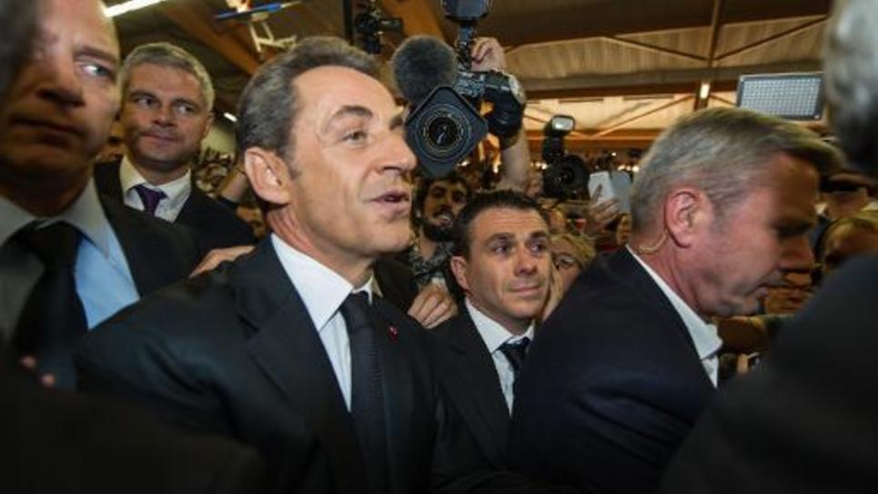 Nicolas Sarkozy (c) à son arrivée à un meeting à Lambersart, le 25 septembre 2014