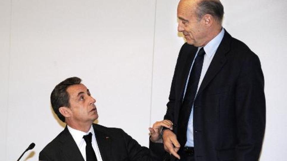 Nicolas Sarkozy et Alain Juppé au siège de l'UMP, le 3 décembre 2014