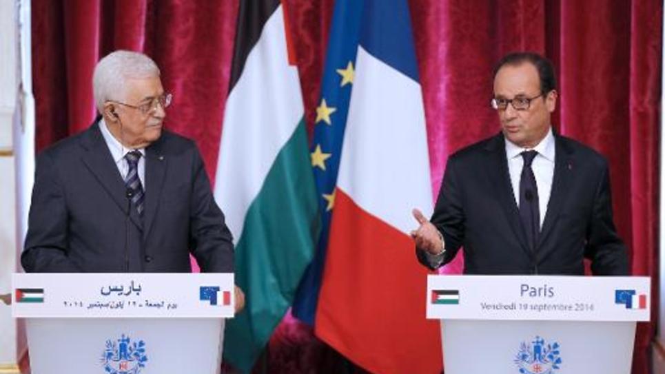 Le président français François Hollande et le président palestinien Mahmoud Abbas à l'Elysée, le 19 septembre 2014 à Paris