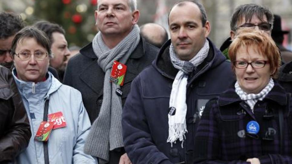 Le secrétaire général de la CFDT Laurent Berger et l'ex-secrétaire général de la CGT Thierry Lepaon lors de la Marche républicaine à Paris le 11 janvier 2015
