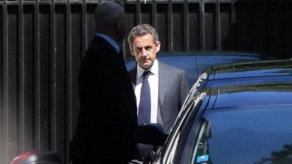 Nicolas Sarkozy à la sortie de son domicile le 2 juillet 2014 à Paris