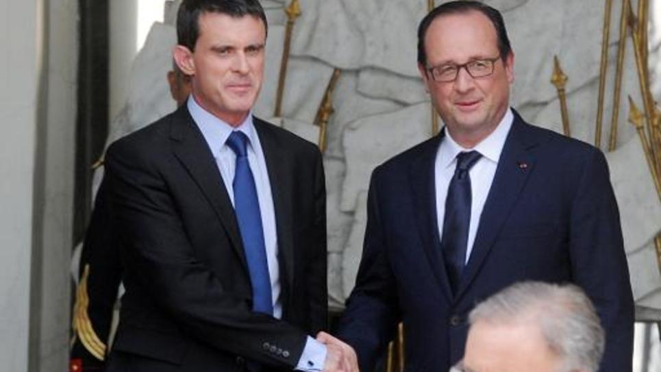 François Hollande et Manuel Valls à la sortie du dernier séminaire gouvernemental avant la pause estivale, le 1er août 2014 au Palais de l'Elysée