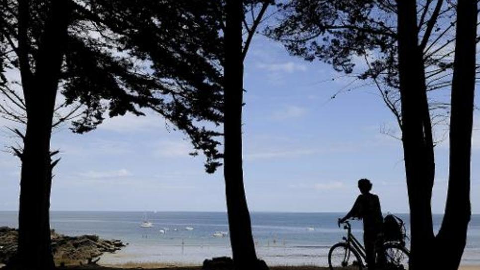 Le ministre des Finances Michel Sapin et la ministre de la Santé Marisol Touraine ont choisi l'île d'Yeu (photographie du 26 juillet 2013) pour passer leurs vacances