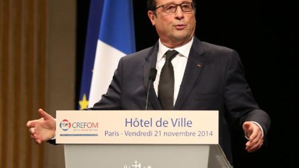Le président François Hollande s'adresse aux représentants des Français d'outre-mer, le 21 novembre 2014 à l'Hôtel de Ville de Paris