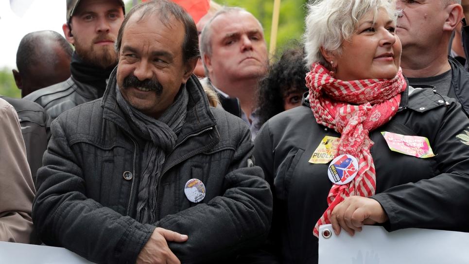 Le secrétaire général de la CGT Philippe Martinez (G) lors d'une manifestation le 9 mai 2019 à Paris
