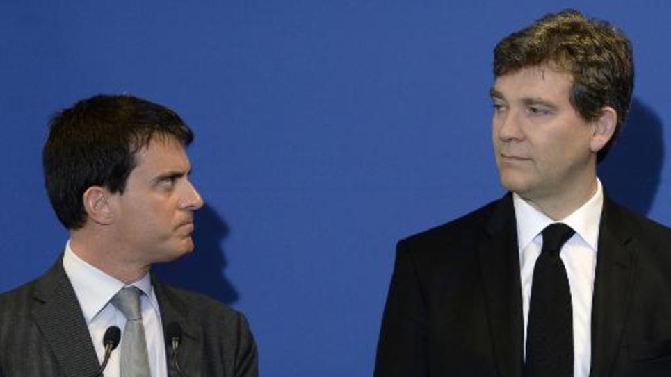 Manuel Valls (g) et Arnaud Montebourg, le 12 mai 2014 à Faverges