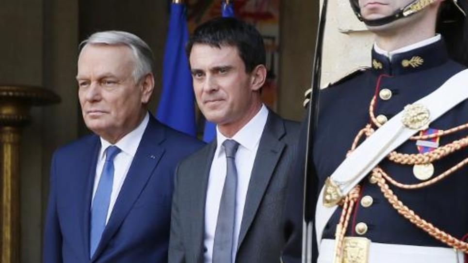 Passation de pouvoirs entre Jean-Marc Ayrault et Manuel Valls, le 1er avril 2014, à l'Hôtel Matignon, à Paris