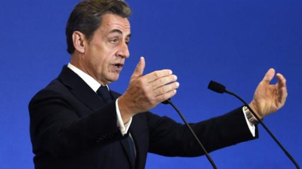 Le président de l'UMP et ex-président de la République Nicolas Sarkozy durant un meeting dans les locaux de son parti, le 13 décembre 2014 à Paris