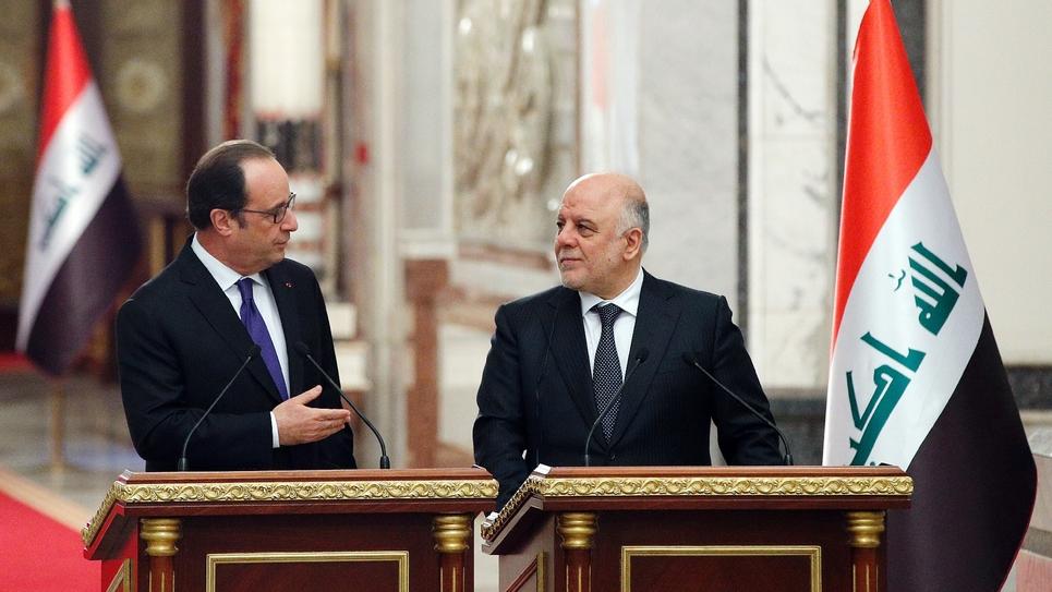 Le président Francois Hollande et le Premier ministre Haider al-Abadilors d'une conférence de presse le 2 janvier 2017 à Bagdad