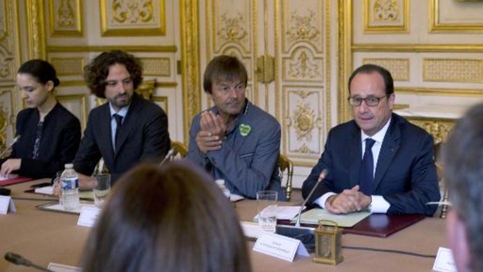 L'activiste écologiste Nicolas Hulot aux côtés du président de la République François Hollande au Palais de l'Elysée à Paris le 20 septembre 2014