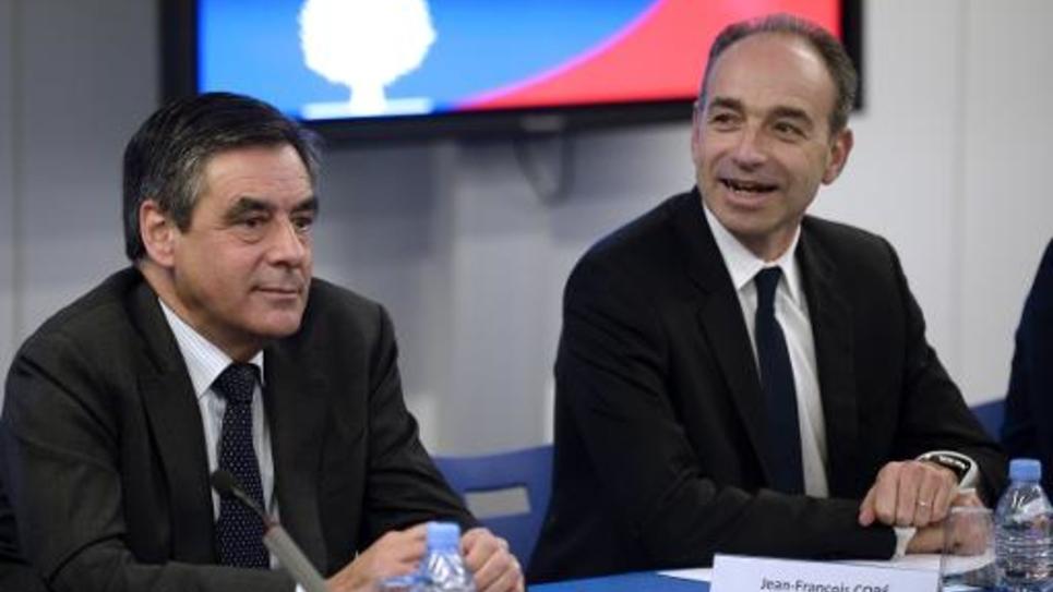 François Fillon, ancien Premier ministre et membre de l'UMP (g) et Jean-François Coppé (d), alors président de l'UMP (d), le 18 décembre 2013