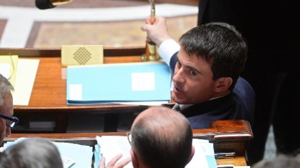 Le Premier ministre Manuel Valls et le ministre de l'Intérieur Bernard Cazeneuve le 28 mai 2014 à l'Assemblée nationale à Paris