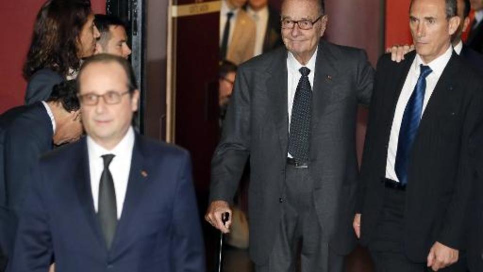 Le président de la République François Hollande suivi par l'ancien président Jacques Chirac au musée de Quai Branly à PAris le 21 novembre 2014