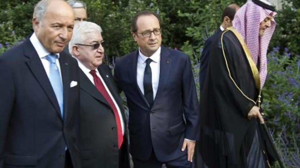 De g à d: le ministre français des Affaires étrangères Laurent Fabius, le président irakien Fouad Masum, le président François Hollande, le ministre saoudien des Affaires étrangères Saud al Faiçal, à Paris pour la conférence sur l'Irak, le 15 septembre 2014
