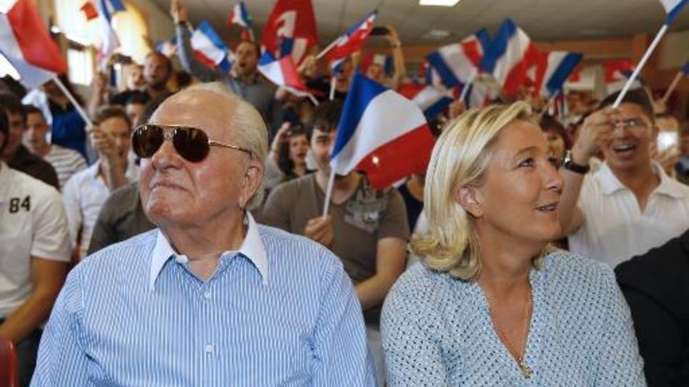 Marine Le Pen (droite) et Jean-Marie Le Pen à Fréjus le 7 septembre 2014