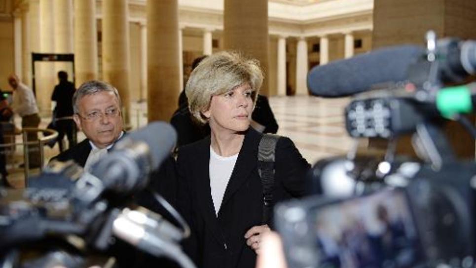 Sylvie Andrieux et son avocat Gaëtan Di Marino à leur arrivée le 2 juin 2014  au palais de justice d'Aix-en-Provence