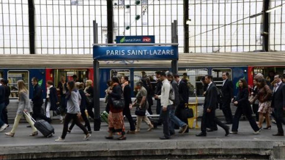 Des voyageurs le 17 juin 2014 gare Saint-Lazare à Paris au 7e jour de la grève des cheminots