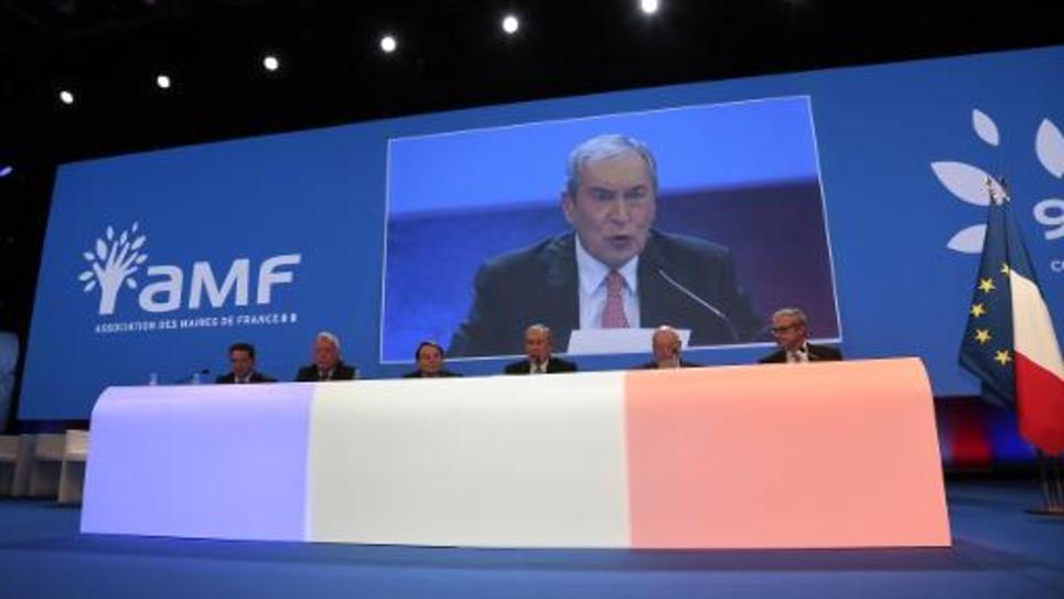 Le président de l'AMF, Jacques Pélissard (sur l'écran) lors du congrès de l'organisation en 2013 à Paris
