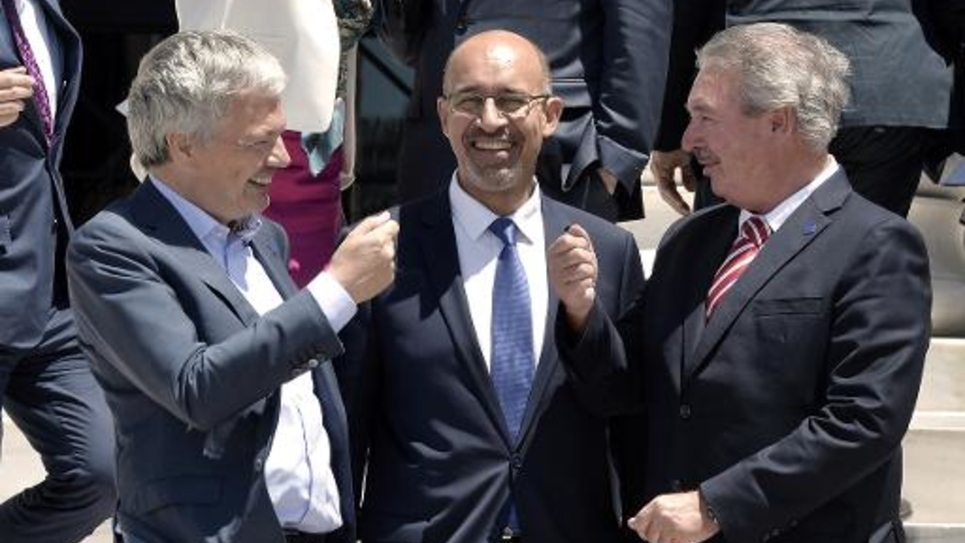 Le Premier ministre belge Didier Reynders (g), Harlem Désir (c) et le ministre des Affaire étrangères luxemburgeois Jean Asselborn à Athènes le 30 mai 2014