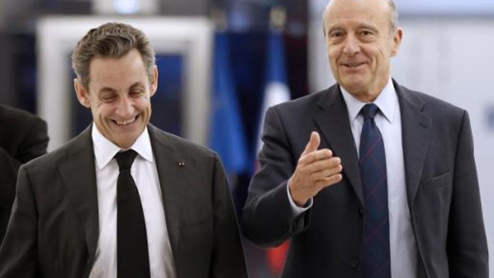 L'ancien président Nicolas Sarkozy et le maire de Bordeaux Alain Juppé au siège de l'UMP à Paris, le 3 décembre 2014