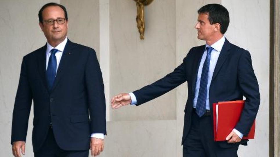 Le président François Hollande et le Premier ministre Manuel Valls à la sortie de l'Elysée, le 27 août 2014