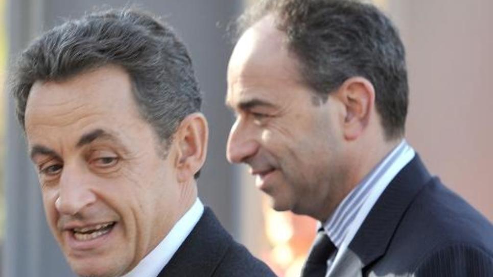 Nicolas Sarkozy (g) et Jean-François Coppé, arrivent à une conférence à Marseille le 8 décembre 2011