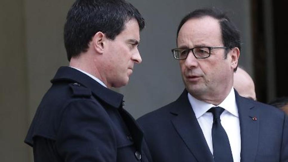 François Hollande et Manuel Valls sur le perron de l'Elysée le 10 janvier 2015 à Paris