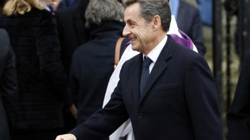 Le président de l'UMP Nicolas Sarkozy lors de la cérémonie à la mémoire de l'ancien Comissaire européen Jacques Barrot le 8 décembre 2014 à Paris