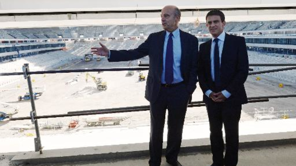 Alain Juppé (g) et Manuel Valls, le 23 octobre 2013 à Bordeaux