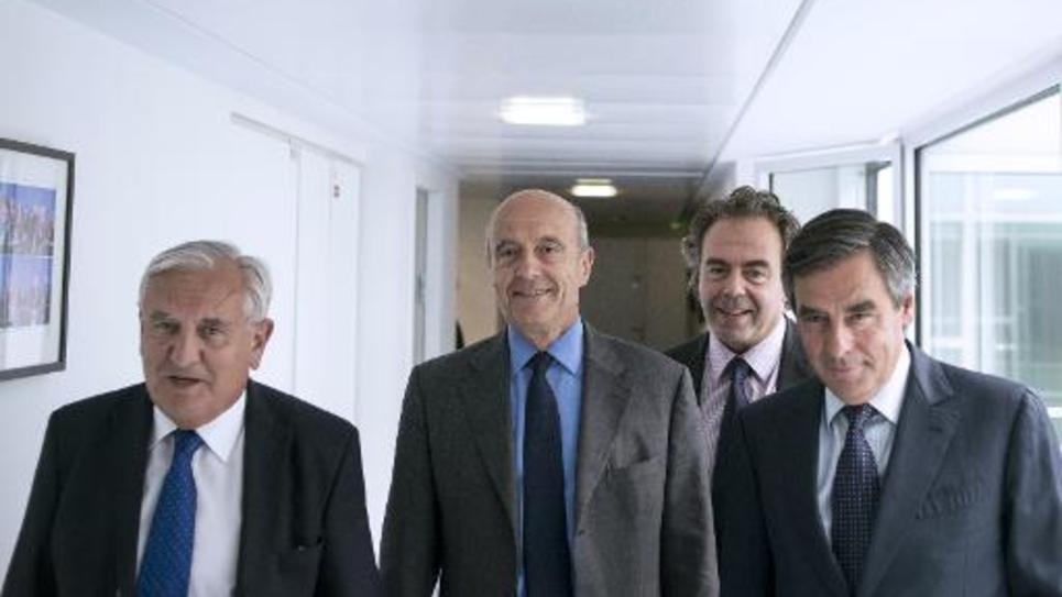 La direction intérimaire de l'UMP les anciens Premiers ministres Jean-Pierre Raffarin, Alain Juppé et François Fillon et l'ex-ministre de l'Education Luc Chatel au siège du parti à Paris le 17 juin 2014
