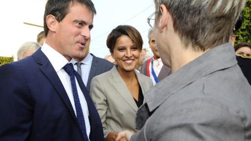 Le Premier ministre Manuel Valls (g) et Najat Vallaud-Belkacem, nouveau ministre de l'Education, le 4 septembre 2014 lors d'une visite dans une école primaire à Saulxures-Les-Vannes, en Meurthe-et-Moselle