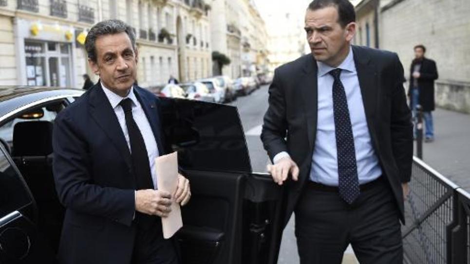 Nicolas Sarkozy arrive au siège de l'UDI à Paris le 23 mars 2015 pour une réunion