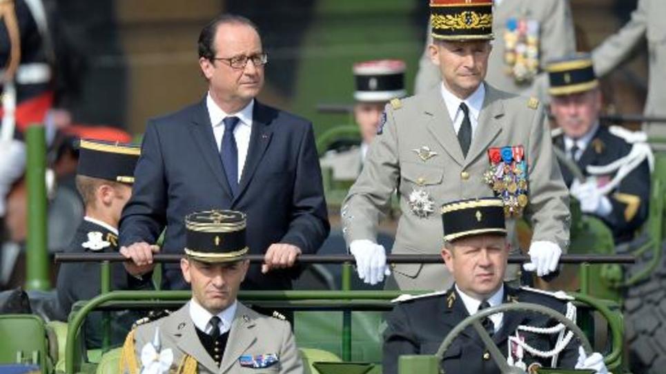 Le président François Hollande et le chef d'Etat-major de l'armée Pierre de Villiers lors de la parade du 14 juillet 2014 à Paris