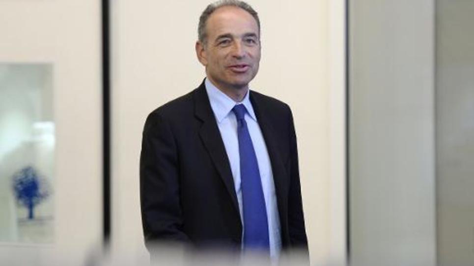 Jean-François quitte le siège de l'UMP à Paris, le 10 juin 2014