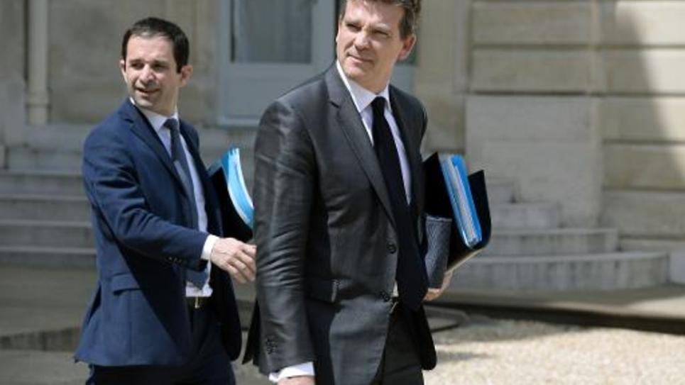 Benoît Hamon et Arnaud Montebourg dans la cour de l'Elysée à la sortie du Conseil des ministres  le 11 juin 2014 à Paris