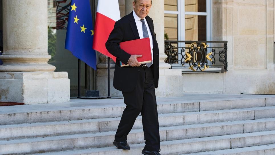 Le ministre des Affaires étrangères Jean-Yves Le Drianquitte l'Elysée, le 3 août 2018 à Paris