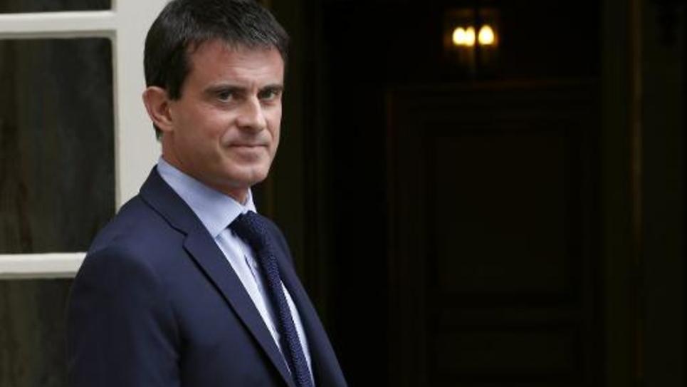 Le Premier ministre Manuel Valls devant l'hôtel Matignon, le 27 juin 2014 à Paris