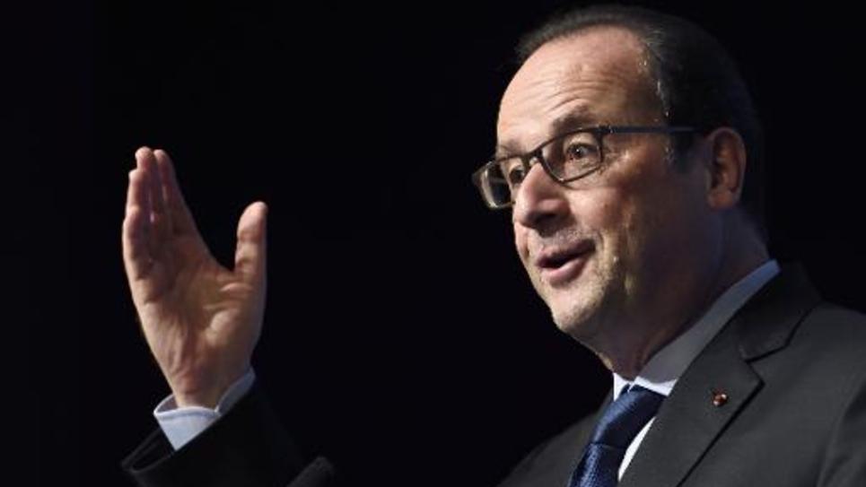 Le président de la République François Hollande au  Centre des nouvelles Industries et technologies (CNIT) à La Défense, en banlieue de Paris, le 16 octobre 2014