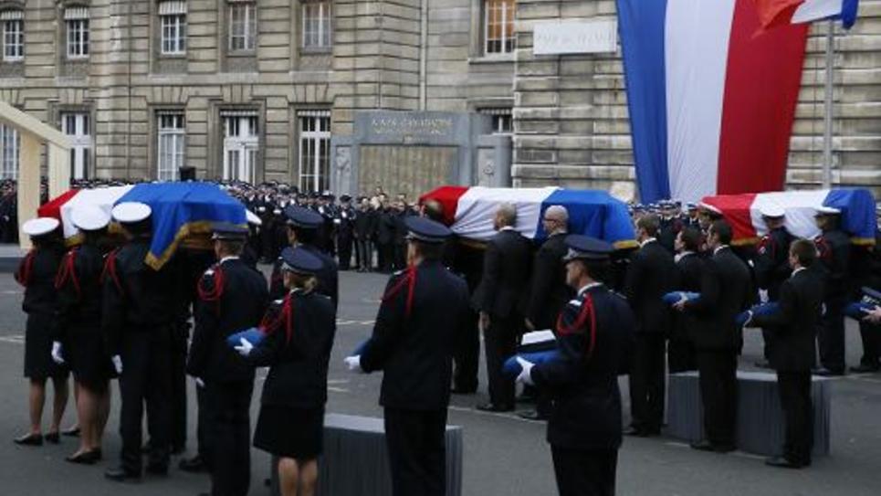 Hommage le 13 janvier 2015 à la préfecture de police de Paris aux trois policiers tués