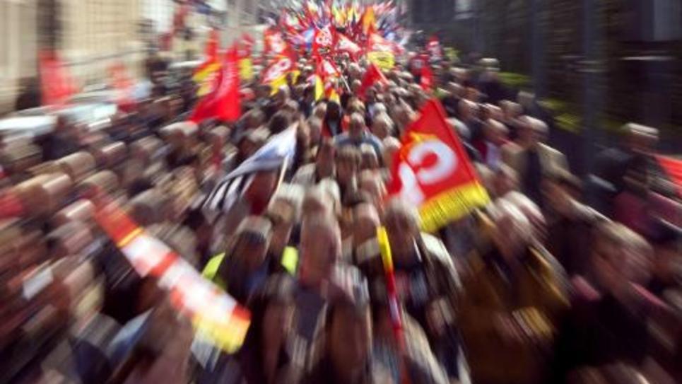 La CGT et la CFDT dénoncent la décision de Ségolène Royal de reporter sine die l'écotaxe