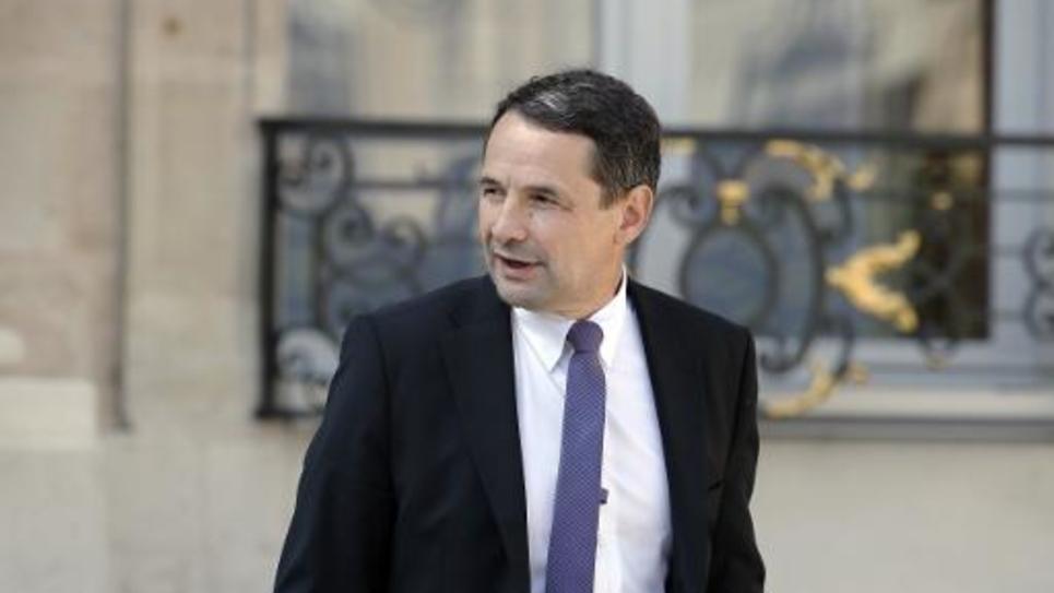 Le secrétaire d'Etat à la réforme de l'Etat sort du palais de l'Elysée, à Paris, le 10 septembre 2014