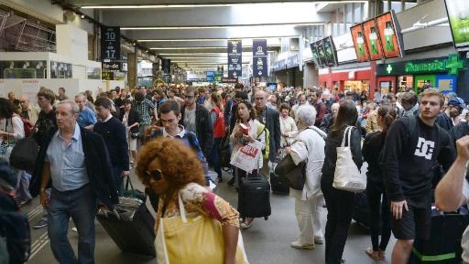 Des voyageurs gare Montparnasse le 20 juin 2014 à Paris