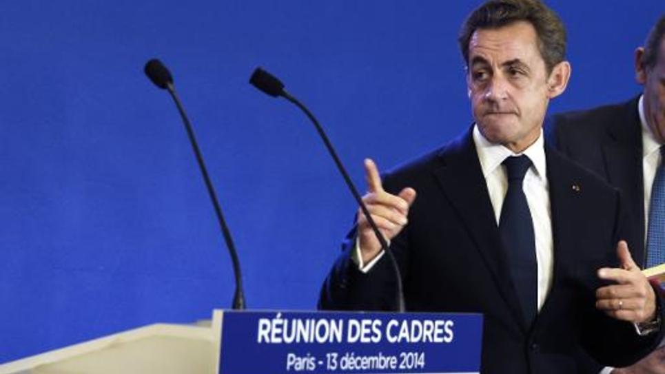 L'ancien président Nicolas Sarkozy au siège de l'UMP à Paris, le 13 décembre 2014