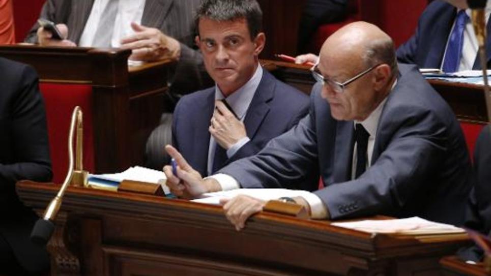 Le Premier ministre Manuel Valls (G) à l'Assemblée à Paris le 17 septembre 2014