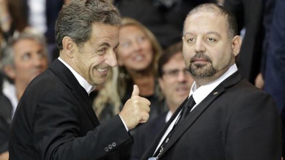 Nicolas Sarkozy (g) lors de la rencontre de Ligue 1 entre le Paris Saint-Germain et l'AS Saint-Etienne au Parc des Princes de Paris, le 31 août 2014