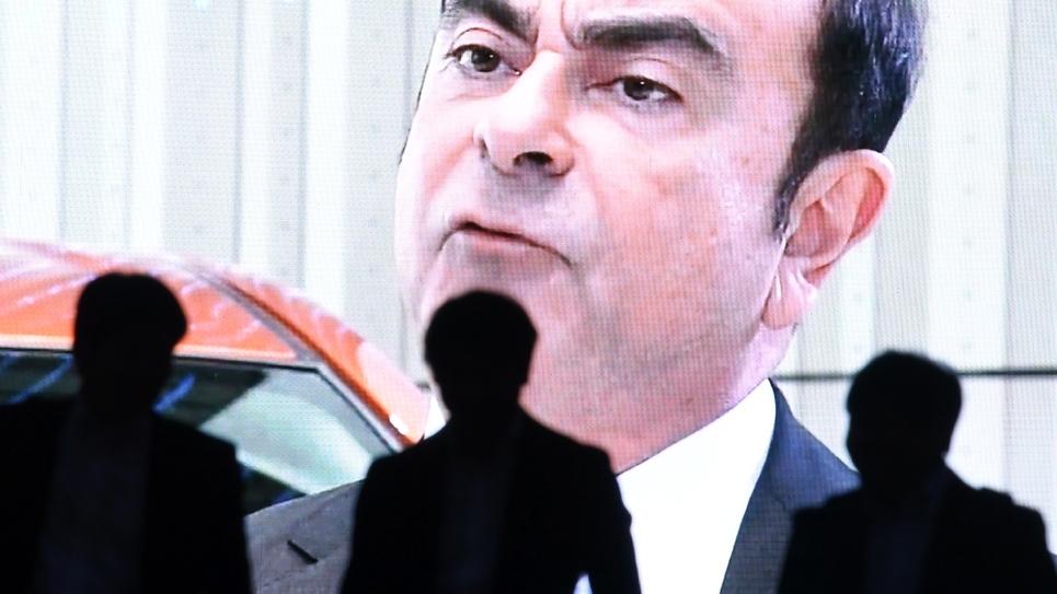 Le portrait de Carlos Ghosn diffusé par la télévision japonaise sur un écran géant à Tokyo, le 20 novembre 2018