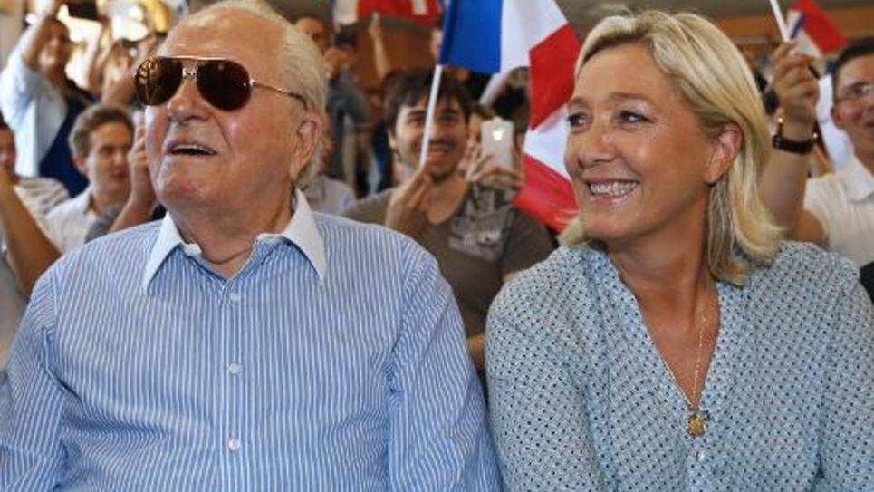 Marine Le Pen, leader du Front National, et son père Jean-Marie le Pen, le 7 septembre 2014 à Fréjus