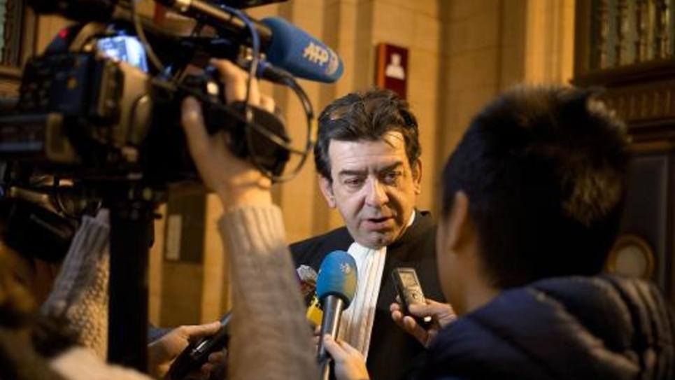 L'avocat du vice-président du FN Florian Philippot, Grégoire Lafarge répond aux questions des journalistes, le 22 décembre 2014 au tribunal correctionnel de Paris